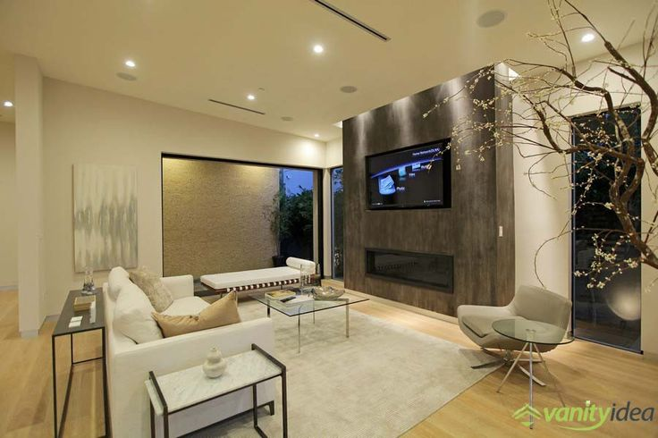 the livingroom is decorated modern and elegant