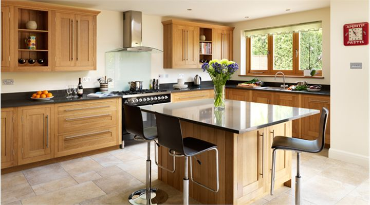 Oak kitchen - black counter but light floor - Modern accents, including bar…