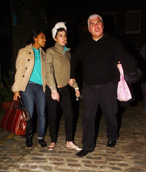 Amy Winehouse And Mitch Winehouse Leaving Her House