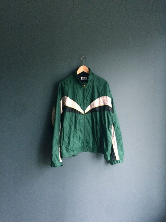 Size = XL  Label = Fila  Condition = 9/10 vintage condition  Rad nylon Fila batwing windbreaker jacket in shiny dark green with silver/black