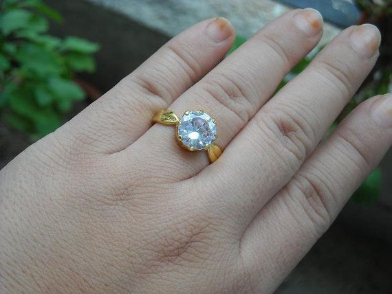 Hey, I found this really awesome Etsy listing at https://www.etsy.com/listing/105062612/18k-gold-wedding-ring-white-topaz-ring