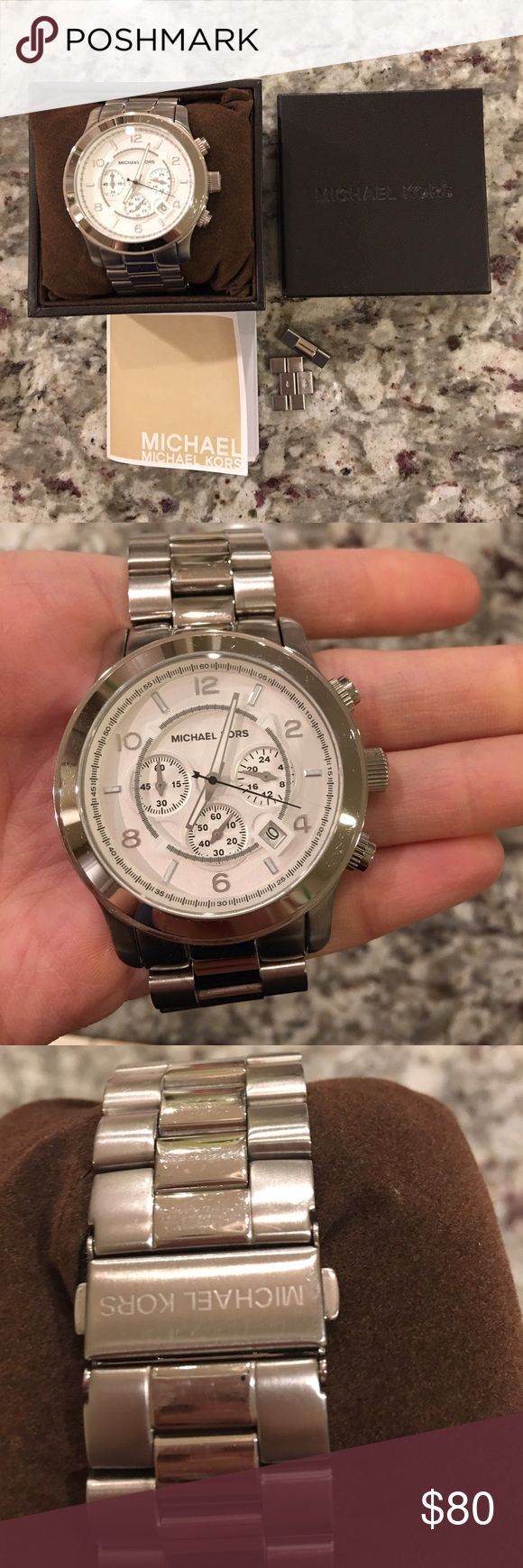 Michael Kors silver Lexington chronograph watch Michael kors silver Lexington 44mm watch. A few very fine surface scratches. This has been worn about 5 times. Can be for men or as an oversized female watch. Comes with box, extra links, instruction manual. Needs a new battery. Michael Kors Accessories Watches