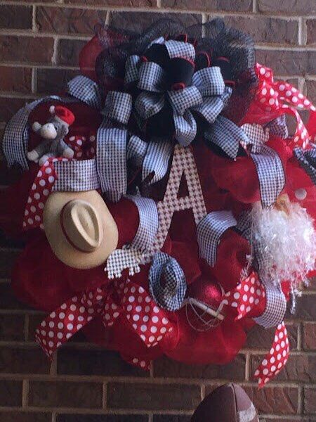 A personal favorite from my Etsy shop https://www.etsy.com/listing/493886881/alabama-football-wreath-houndstooth