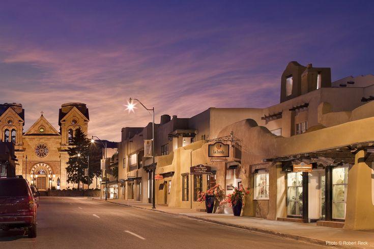 San Francisco Street with La Fonda Hotel and the Basilica of St. Francis. Santa…