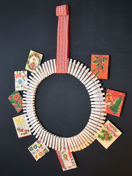 clothespin wreath hanging from ribbon