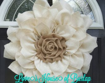 This White Burlap flower is a perfect addition to any home decor. It can be used as a wreath or as wall decor. The frame is not included. It
