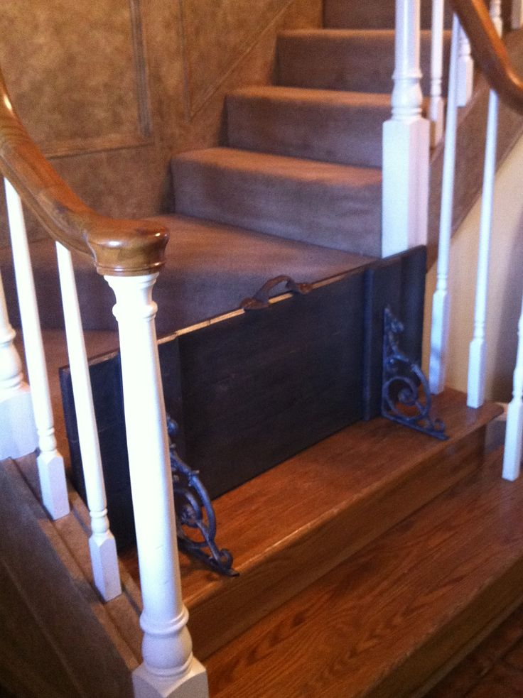 Custom Dog Gate - Took an exterior shutter  cut to size; added decorative metal brackets and a decorative metal handle.  Looks great and functions well.  Easy to lift up and sit on landing for ease of accessing stairs.