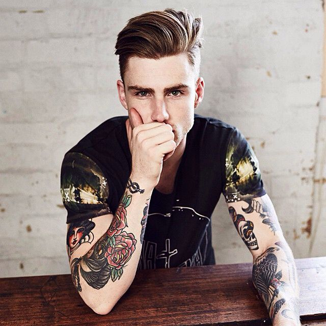 I'm Gavyn Cartwell and I'm nineteen years old. I'm originally from Erudite but I made it through the initiation with flying colors. I run a tattoo parlor in the Pit and I get frequent customers. I live above the parlor with my girlfriend, Lena, and when she's not working, she helps me down there.
