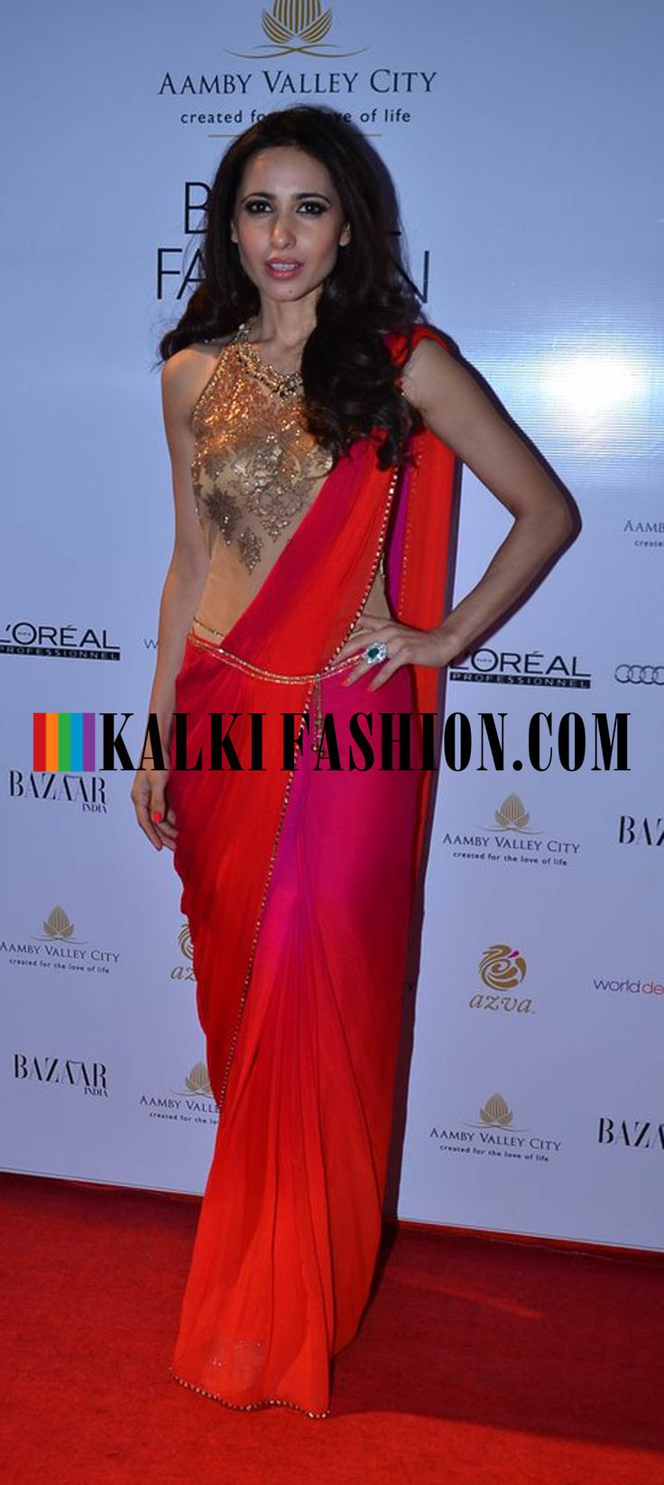 http://www.kalkifashion.com/ A celebrity in shaded saree attending the ongoing Indian Bridal Week