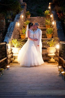 44-same-sex-wedding-north-devon-nighttime-lights-kiss-stairs