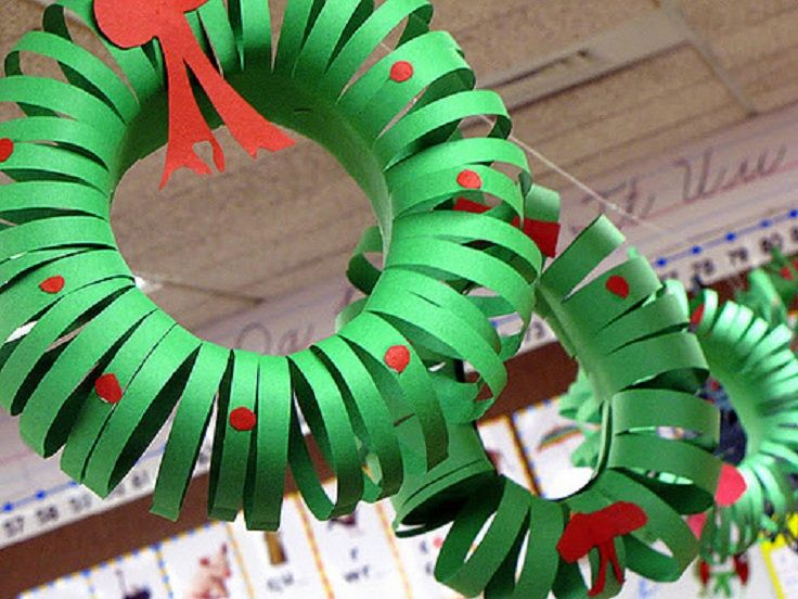 Construction Paper Wreaths- Construction paper, scissors, glue or tape, red construction paper for holly berries