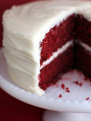 After yesterday's post, I thought it was only appropriate to follow up with the real thing. No purse this time. This is all cake. Velvety and yes … red. And delicious. And moist. And one of my favorites. It's covered in cream cheese frosting that's to die for. Help me. There's something about a red velvet cake that always makes me feel good inside. And it's not just the taste. It's the memories it brings of family and holidays and home. But it doesn't have to be...