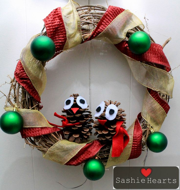 To create this wreath.. You will need some old ribbon, some vines that you have dried for a week or so.. that you have made into a circle.. Two pine cones and decoration of your choice.. Rest is all up to your imagination..