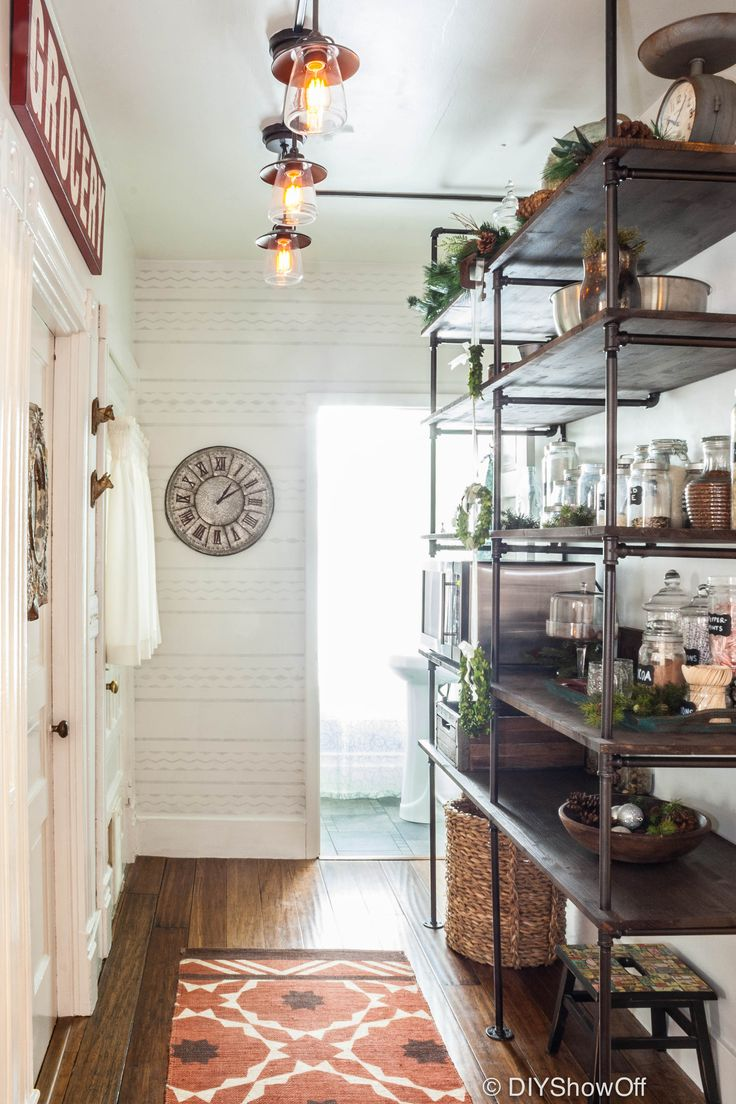 Rustic pantry with DIY industrial pipe shelving for a small space, with plenty of room to  see everything. shelving. Pantry Before and After. | #DIY Tiny Homes