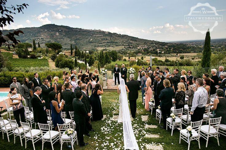 Bridal entrance, looking over Cortona and Tuscan hills. White Chiavari chairs