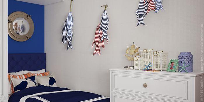 Декор в морском стиле: мягкие подвески-рыбки и зеркало-иллюминатор.