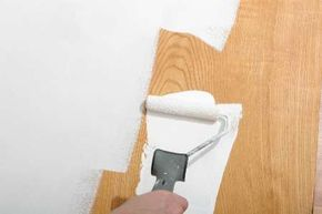 If you want to get rid of the grooves in the paneling altogether, simply use spackle or joint compound to fill them, but AFTER the primer coat so the spackle adheres properly. If the finish coat is going to be semi-gloss, the spackle will have to be primed before applying the semi-gloss paint.
