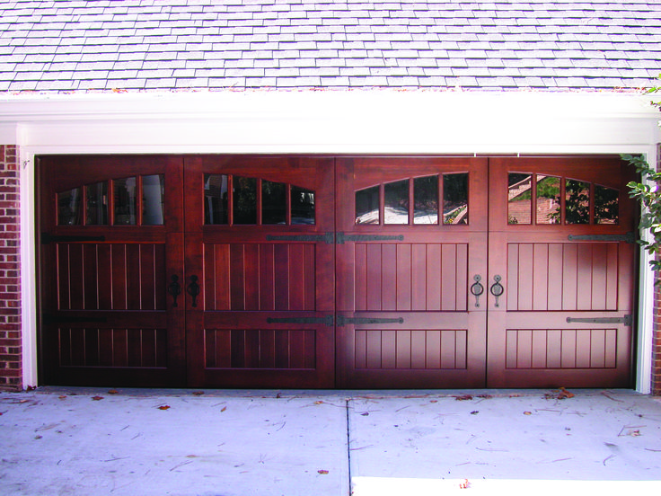 Awesome cedar carriage house door with arched windows for Beautiful garage doors