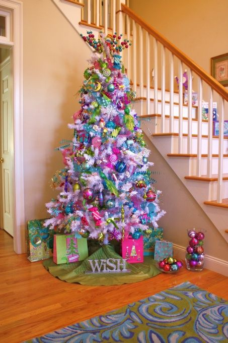 So cute and colorful. Looks like it popped right out of a Seuss book ♥. White Christmas tree adorned in pink, lime green, turquoise and purple.
