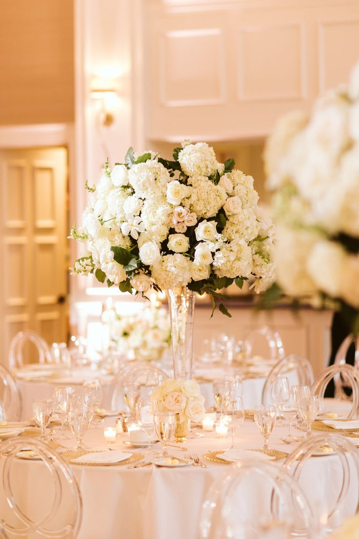 grand ballroom wedding reception featured large classic arrangement of white hy…