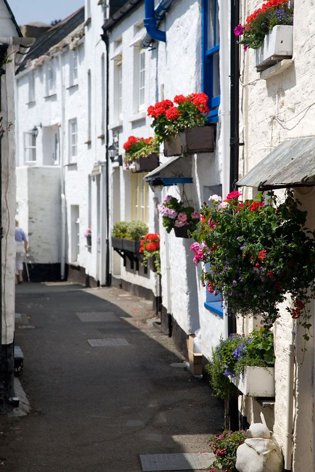 The Warren - Polperro - Cornwall, UK. The warren is located on the eastern side of Polperro harbour where is rises up the hillside towards the coast. It is made up a jumble of narrow, winding streets lined with whitewashed cottages. Originally these would have housed the fishermen and merchants of a thriving port town.