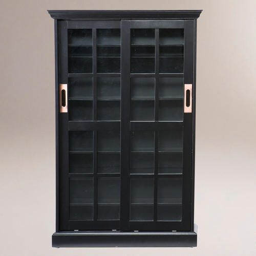 For Jordan: Could this be useful in your living room? WorldMarket.com: Black Sliding Door Bookcase and Media Cabinet