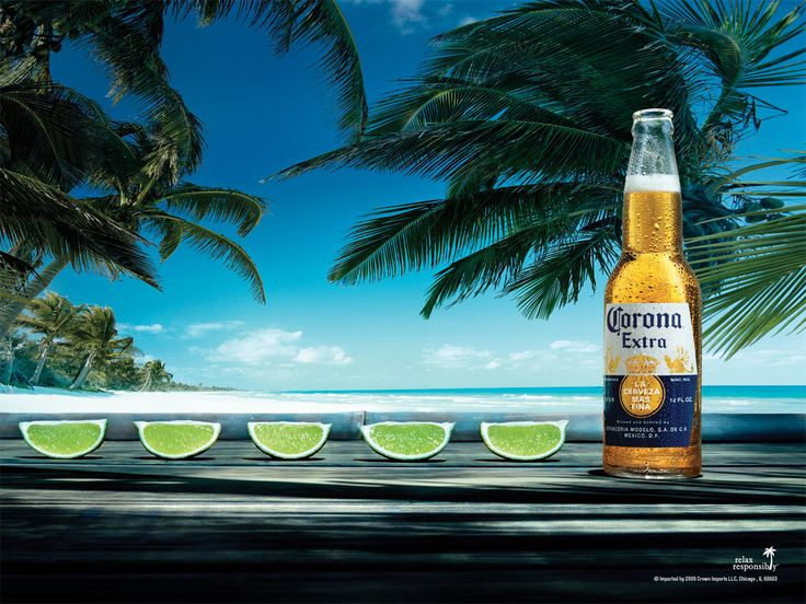 Beer corona with lime at the beach alcohol drink bottle, commercial. No I don't like corona to much. But I LOVE the IDEA drinking on a BEAUTIFUL BEACH & the corona commercial.