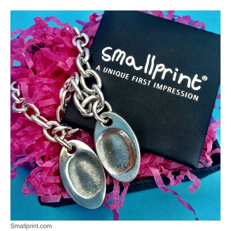 Smallprint fingerprint oval charms made from pure silver - not created from a mould. You get back to wear what your loved one has touched.