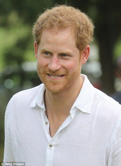 Prince Harry pictured on his third day of the trip...