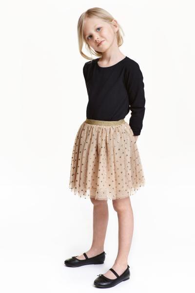 Falda de tul: Falda de tul con lunares metalizados. Cintura elástica brillante y forro de satén.