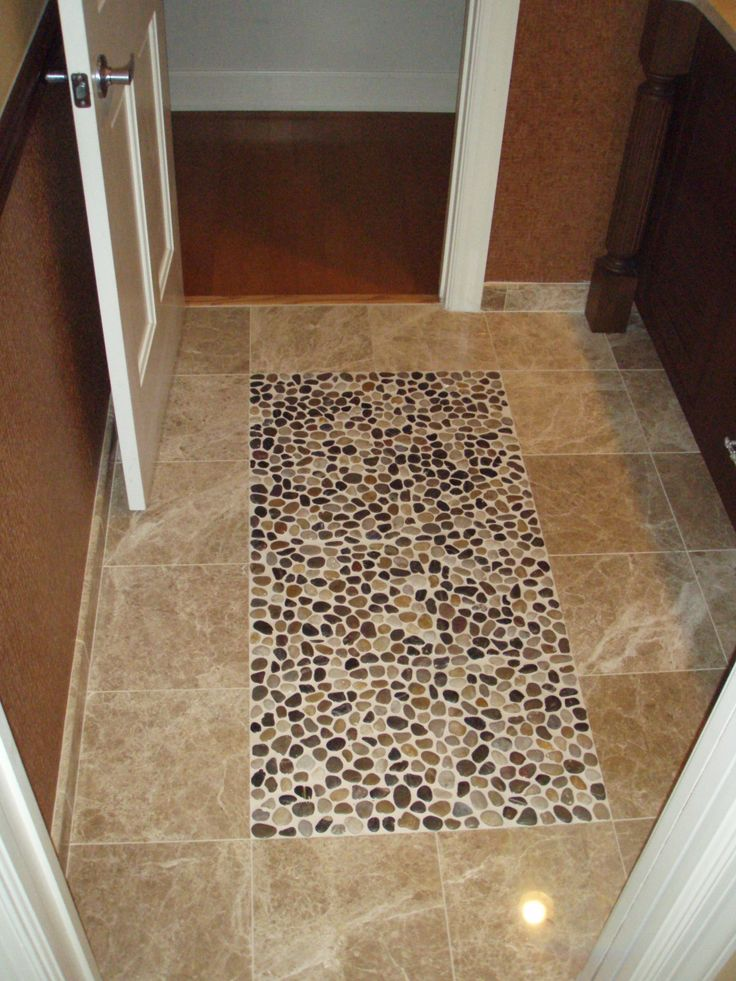 River rock floor on pinterest wood plank tile river rock shower and