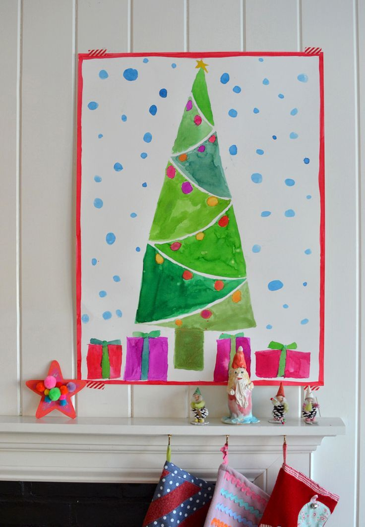 kids use watercolors to paint a Christmas tree on an oversized piece of paper