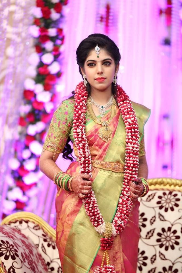 South Indian bride. Gold and diamond Indian bridal jewelry.Temple jewelry. Jhumkis. Coral pink and pale green silk kanchipuram sari.Half updo. Telugu bride. Kannada bride. Hindu bride. Malayalee bride.Kerala bride.South Indian wedding.