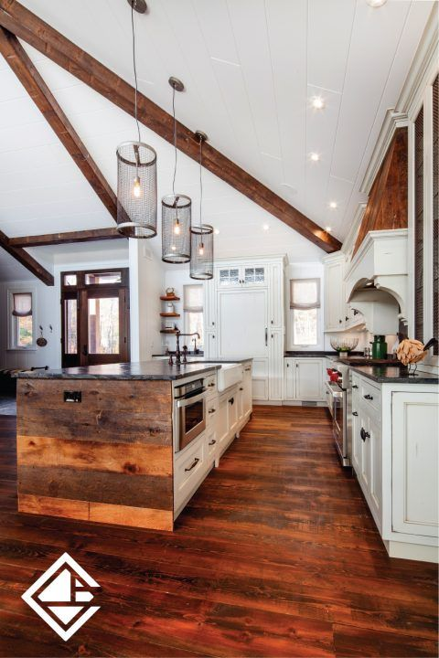 This is a great rustic kitchen that displays various wood tones plus the beautiful granite stone island. There is so much for the eye to see in this gorgeous kitchen including the custom made wood range hood.