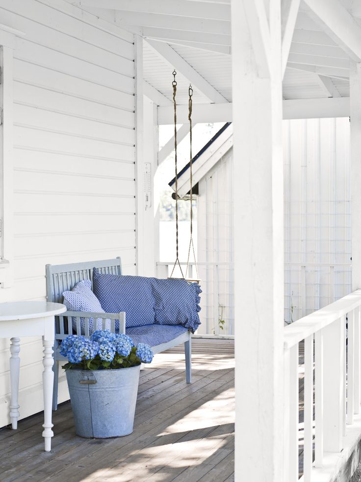 "Sommarhus med veranda - Skonahem...white white white and cool hydrangea blue, ""real"" furniture out on a porch."