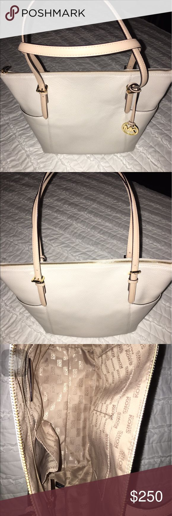 Michael Kors Purse Ivory colored Michael Kors Jet Set Large Tote bag. Not used much at all, basically new. Medium sized bag, not huge. Still stands up alone because leather has not been worn down at all. Willing to negotiate price! Michael Kors Bags Totes