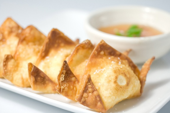 Crab Rangoon. Crabmeat and cream cheese stuffed in wontons, deep fried ...