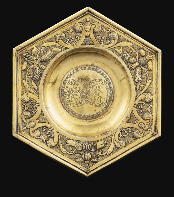 A Hungarian silver-gilt hexagonal plate, maker's from Fogaras (Fugreschmarkt, Făgăraș), Kingdom of Hungary / Transylvania. Engraved with armorials and inscribed MICHAEL TELEKI, and VER IUDIT AN DO 1670. Sotheby's Paris auction.
