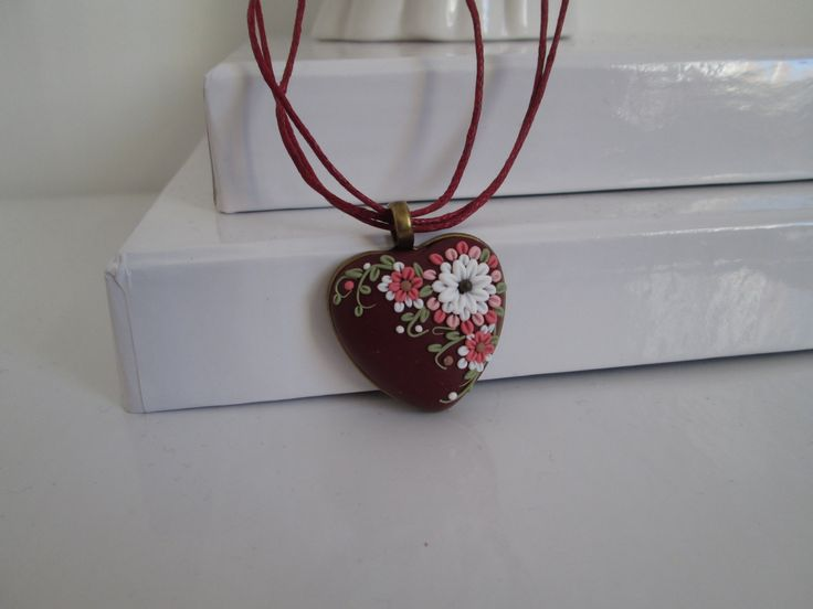 Polymer clay heart pendant made by Fernanda Mccormack