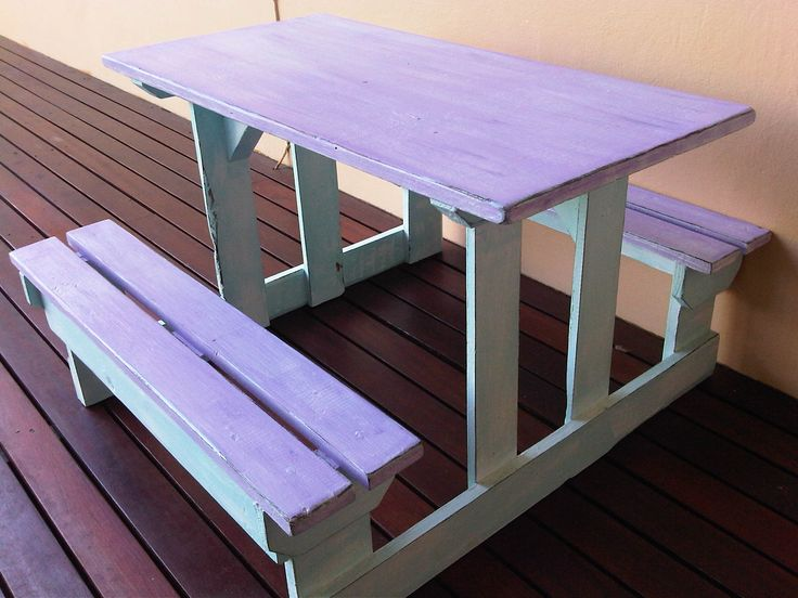 Solid wooden Table with 2 Benches for small Kids in perfect condition. Painted in light blue and purple with Shabby Chic finish. Measurements: H 48 x L 82 x W 82 cm To view more items please visit my Facebook pages at: http://www.facebook.com/ArmstrongHomeDecor