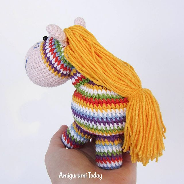Amigurumi pony and rainbow go together like salt and pepper and they are often top of the crocheters' to-do list. Make your own rainbow pony using this free crochet pattern! #freepattern #amigurumitoday #amigurumi #crochet #howto #crochettoy #craft #diy #amigurumipattern #crochetpattern #crochetaddict #crochetlovers #lovecrochet #tutorial #amigurumis #crocheting #crochettoys #crochetforkids #ponies #rainbow  #colorsplash