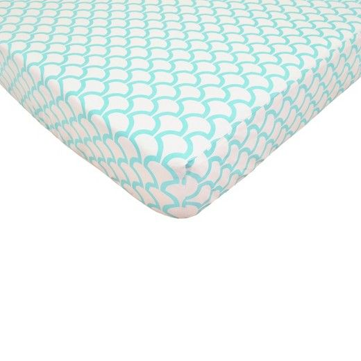 In a stylish ocean-inspired print, this Aqua Sea Waves Fitted Crib Sheet gives your little one a cute place to rest. Coordinating with any nursery decor, this happy-hued fitted sheet is covered in a charming aqua scale-like print. This crib sheet is made of 220 thread count cotton, which is gentle on your baby's delicate skin while it protects your crib mattress. This fitted crib sheet has stretchy elastic edges and fits snugly on standard-size crib mattresses, staying in place unti...