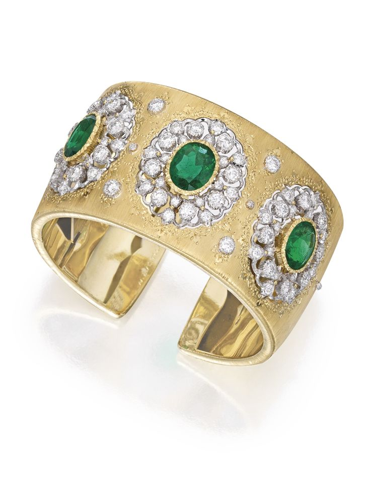 18 KARAT TWO-COLOR GOLD, EMERALD AND DIAMOND CUFF-BRACELET, BUCCELLATI. Of openwork design, set with three oval-shaped emeralds weighing approximately 3.20, 2.85 and 2.75 carats, further accented by round diamonds weighing approximately 3.95 carats, gross weight approximately 55 dwts, internal circumference 6½ inches, signed M. Buccellati Italy.