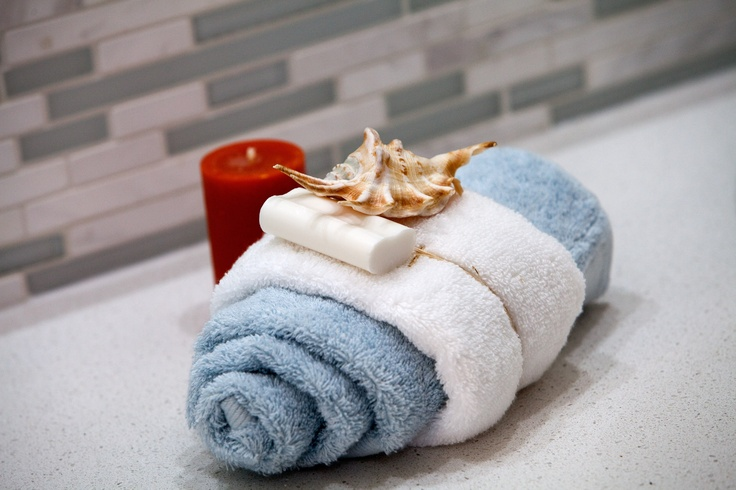 Bring the holiday home by featuring sea shells in your relaxing bathroom