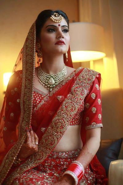 Bridal Portrait - Red Bridal Lehenga with Polki Jewelry   WedMeGood #wedmegood #indianbride #bridalportrait #lehenga #polki #jewelry #indianwedding #maangtikka #necklace