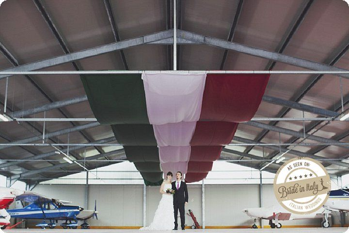 Aeroclub Volovelistico del Mugello, a great place for an unconventional portrait session. Ph Stefano Santucci http://www.brideinitaly.com/2013/11/santuccihangar.html #italianstyle #wedding #tuscany
