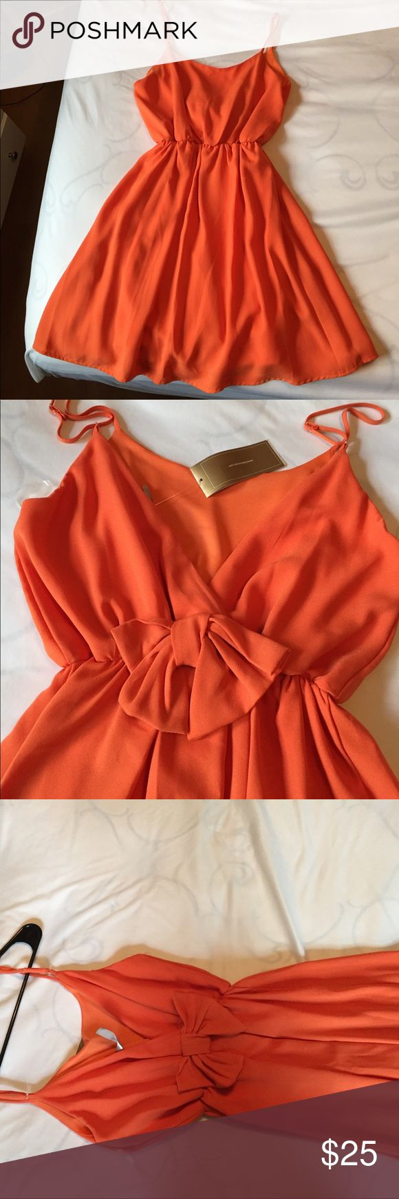 Adorable summer dress! Low back with bow detail! Perfect beach dress/swim cover up! This dress has a V line low back with a pretty bow, the front is simple bet super flattering! Great summer wardrobe addition! Francesca's Collections Dresses Backless