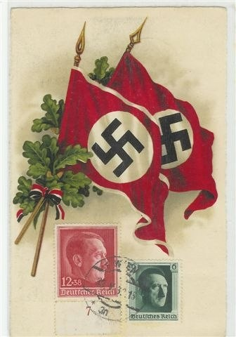 Nazi propaganda postcard depicting Nazi flags. Note the authentic stamps with Hitler's image.