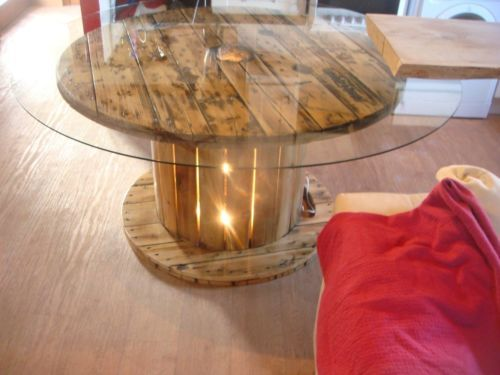 unique cable reel table with large glass top and light box in the centre