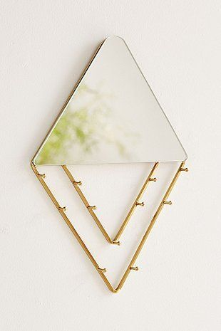 Modern diamond mirror that doubles as a hanging rack for your necklaces. Mix and match different necklaces to create a personalised hanging artwork.